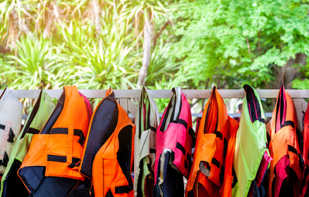 Foto de life jacket in colorful important for life security in the water or the sea and ocean for everybody even someone can swim - Imagen libre de derechos