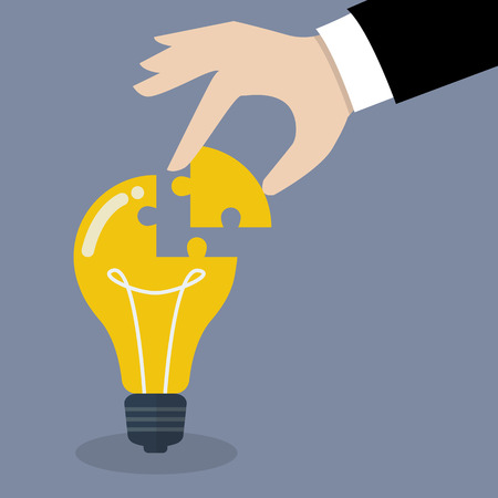 Illustration pour Hand inserts the missing puzzle in lightbulb. Business idea concept - image libre de droit