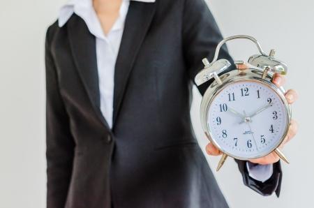 Photo pour Clock on business woman hand - image libre de droit