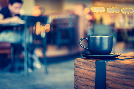 Photo for Coffee mug in coffee shop cafe - Vintage effect style pictures - Royalty Free Image