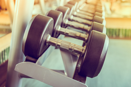 Foto de dumbbell in gym - vintage effect and sun flare filter effect - Imagen libre de derechos
