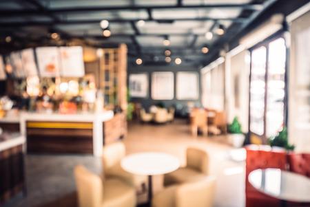 Foto de Abstract blur coffee shop background - vintage filter effect - Imagen libre de derechos