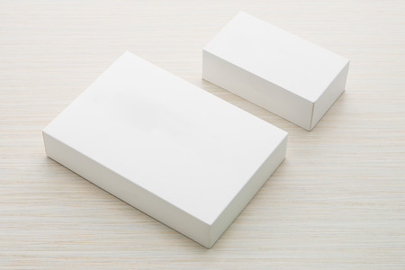 Photo pour White box mock up on wooden background - image libre de droit