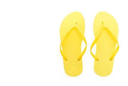 Foto de Yellow flip flops isolated on white background - Imagen libre de derechos