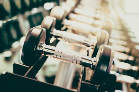 Foto de Selective focus point on Dumbbell in fitness and gym room interior - Vintage filter effect - Imagen libre de derechos