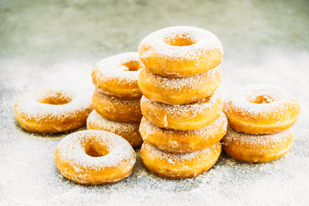 Photo for Sweet dessert with many donut on top with sugar icing - Unhealthy food style - Royalty Free Image