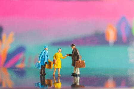 Photo for Miniature people , Tourist handshake with friend on colorfull background - Royalty Free Image