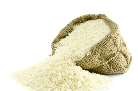 Foto de Rice in Gunny bag with white isolate background  - Imagen libre de derechos