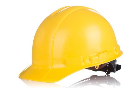 Foto de Yellow Safety helmet with shadows isolated on white background - Imagen libre de derechos