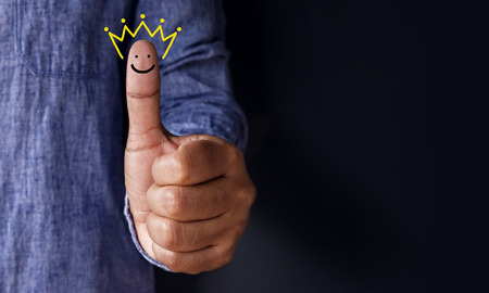 Photo pour Customer Experience Concept, Best Excellent Services Rating for Satisfaction present by Thumb of Client with Crown and Smiley Face icon - image libre de droit