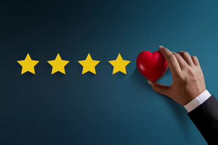 Photo for Customer Experience Concept, Best Excellent Services Rating for Satisfaction present by Hand of Happy Client put a Heart on Five Star - Royalty Free Image