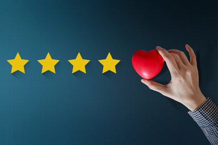 Foto de Customer Experience Concept, Best Excellent Services Rating for Satisfaction present by Hand of Happy Client put a Heart on Five Star - Imagen libre de derechos