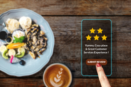 Foto de Customer Experience Concept. Woman using Smartphone in Cafe or Restaurant to Feedback Five Star Rating in Online Satisfaction Survey Application, Food Review, Top View - Imagen libre de derechos