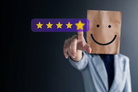 Photo pour Customer Experiences Concept. Happy Business Woman with Smiling Face on Paper Bag Giving Five Star Rating for her Satisfaction. Client's Feedback and Review - image libre de droit