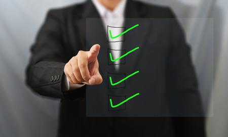Photo pour business man touch check list - image libre de droit