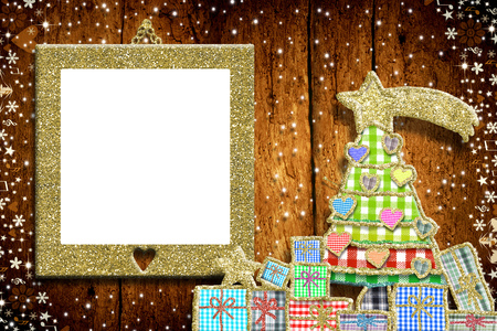 Photo for Christmas empty photo frame greeting card.  Christmas tree and gifts made with cheerful cuts of fabrics and golden glitter, gold glitter empy photo frame on old wooden wall. - Royalty Free Image