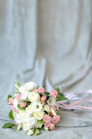 Foto de Isolated bouquet of flowers at photo studio in blue background. Concept of floristic art and photo session. - Imagen libre de derechos
