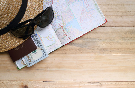 Photo for travel concept,  Preparation for travel,  money, passport, road map on wooden table - Royalty Free Image
