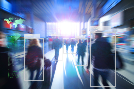 Foto de technology of machine or robot  Learning analytics identify human technology , Software  analytics and recognition people in city with flare light effect ,Artificial intelligence concept. - Imagen libre de derechos