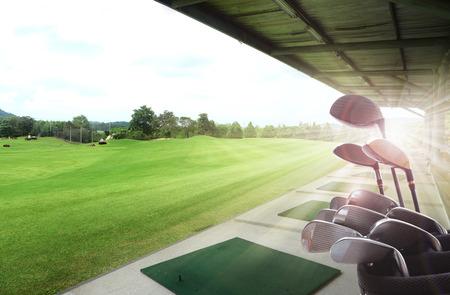 Photo pour Golf clubs drivers over beautiful golf driving range - image libre de droit