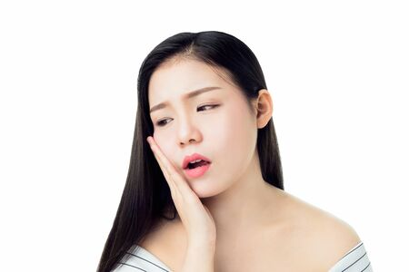 Photo pour Asian girl in white casual dress Show off the toothache, Maybe because of not maintaining good oral health. on a white background gives a soft light. - image libre de droit