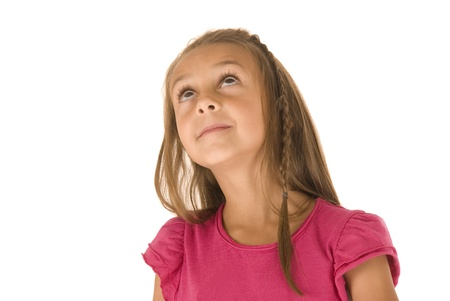 cute young girl looking up in pink