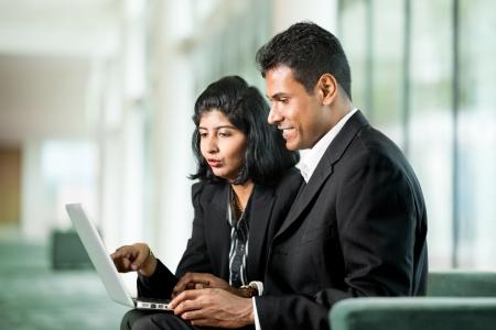 Foto de Indian Business colleagues working together around a laptop - Imagen libre de derechos