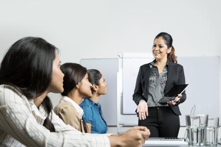 Foto de Indian business woman giving presentation with her digital tablet. - Imagen libre de derechos