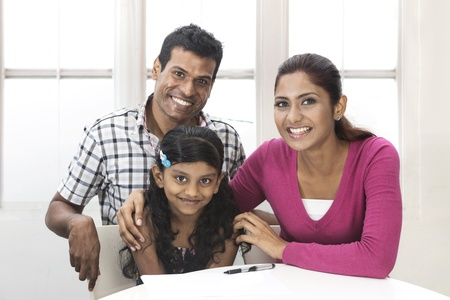 Portrait of a Indian family in kitchen relaxing together.