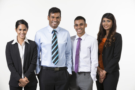 Photo pour Team of four  happy Indian business people. isolated on a white background. - image libre de droit