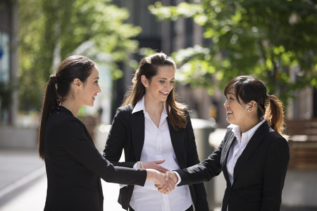 Foto de Caucasian Business women shaking hands. Business concept. - Imagen libre de derechos