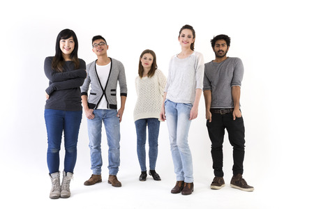 Foto de Happy group of friends. Mixed race group. Isolated on a white background. - Imagen libre de derechos