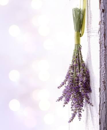 Photo for Lavendar hanging from an old vintage door, room for copy space - Royalty Free Image