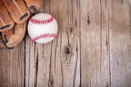Baseball and mitt on rustic wooden background mural