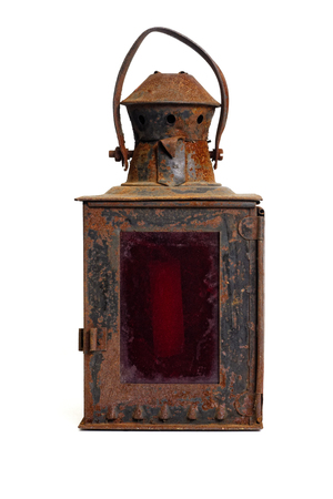 Foto de Isolated objects: very old shabby and rusty lantern, with red glass, on white background - Imagen libre de derechos