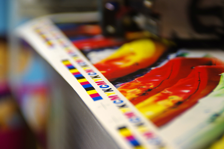 Photo for Inkjet plotter printing CMYK mark on white paper. Large digital printer machine. - Royalty Free Image
