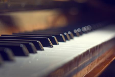 Foto de Piano keyboard background with selective focus. Warm color toned image - Imagen libre de derechos
