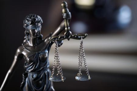 Foto de Law and Justice concept. Brown wooden background - Imagen libre de derechos
