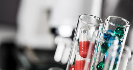 Foto de Laboratory Microscope. Scientific and healthcare research background .. drug tests tubes - Imagen libre de derechos