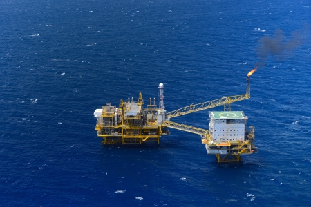 the top view offshore oil rig platform take from aircraft