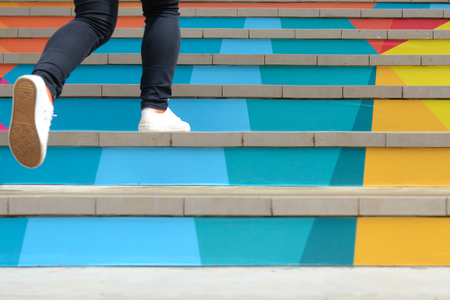 Photo for Lower part of teenage girl in casual shoe walking up outdoor colorful stair,teenage lifestyle successful concept - Royalty Free Image