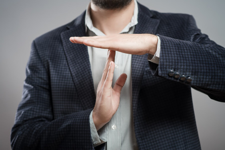 Photo pour young businessman showing time out sign with hands against - image libre de droit