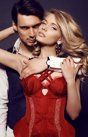 Foto de fashion studio photo of beautiful sensual couple in elegant clothes - Imagen libre de derechos