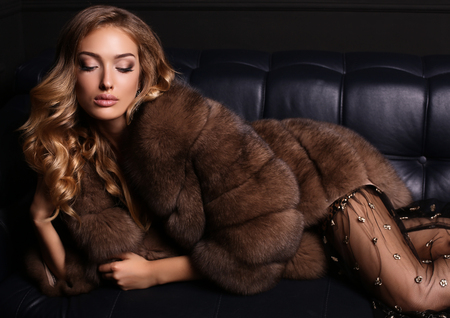 Photo for fashion studio photo of gorgeous sensual woman with blond hair in luxurious dress and fur coat - Royalty Free Image