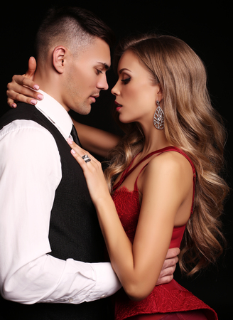Photo pour fashion studio photo of sensual beautiful couple. gorgeous woman with blond hair and handsome man - image libre de droit