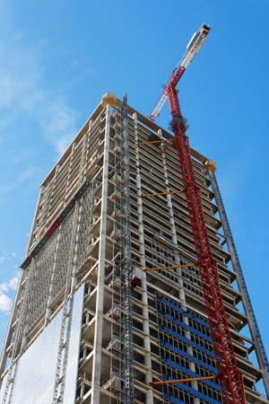 Photo for Lifting crane and high building under construction  - Royalty Free Image