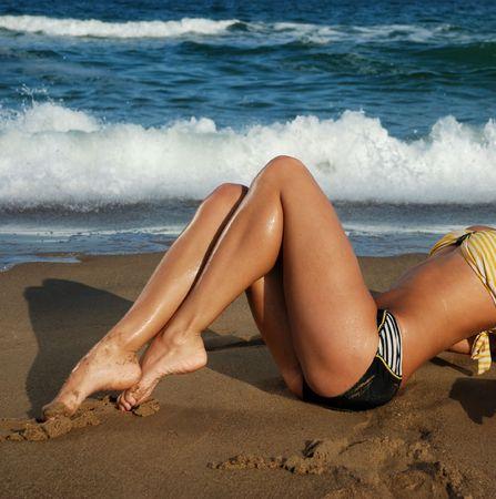tan legs on a beautiful tropical beach