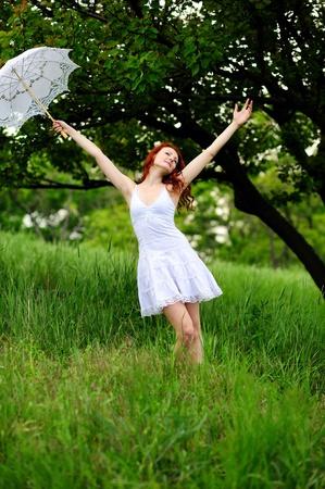 Happy girl portrait, walking with umbrella in park  Outdoor