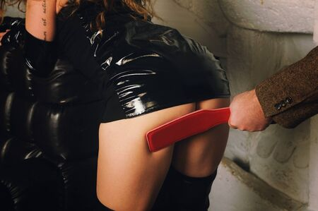 Foto de Spanking paddle, BDSM style fetish, cute woman ass - Imagen libre de derechos