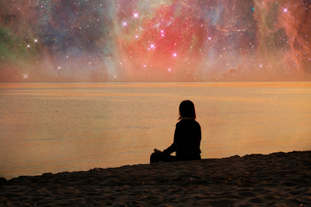 Photo pour Follow your dreams, silhouette of woman meditaiting on the beach many stars above- elements of this image are furnished by NASA - image libre de droit